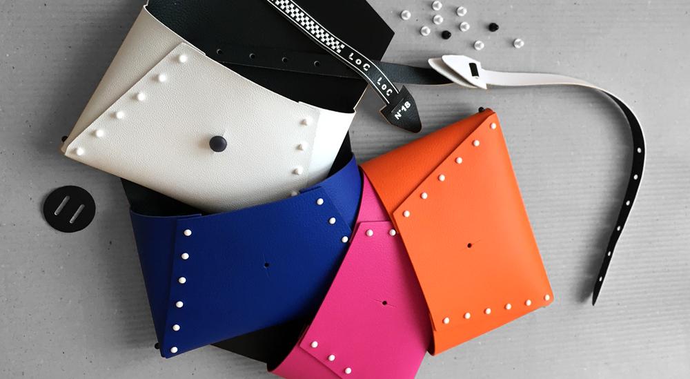 costruire la borsa pollicina composta da un unico pezzo di pelle reversibile bi-color è molto semplice, bastano le tue mani e lembi di pelle del kit uniti insieme con chiodini gemelli bottoni di plastica bianchi o neri smontabile reversibile
