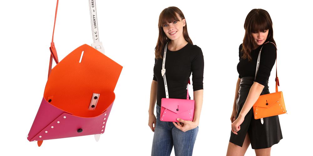 borsa pollicina fuxia arancio assemblata e costruita con pelle double face indossata da una ragazza nelle due versioni colore